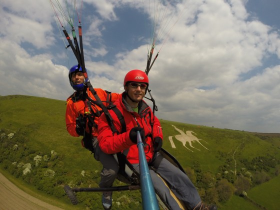 Chris and Andrew flying with the White Horse visible in the hill behind them
