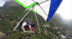 Mark flying over Rio with control of the hangglider