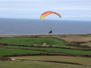 A Flychair buggy in flight above the Dorset coast