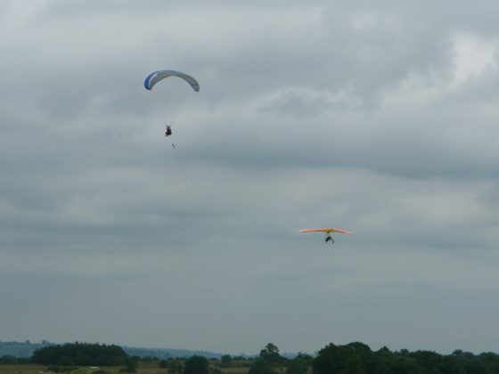 A paraglider and a tandem hangglider at Airways Airsports
